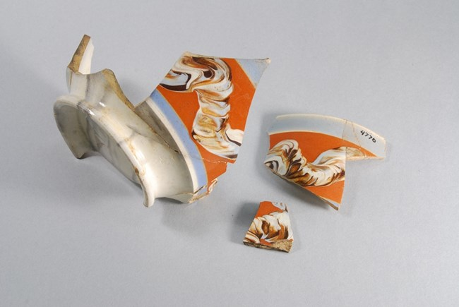 Three bowl fragments with swirling design