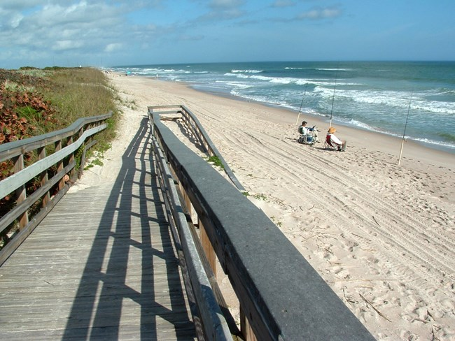 boardwalk ramp to sandy beach