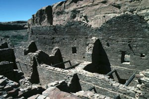 [photo] Ruins of masonry buildings in desert valley.