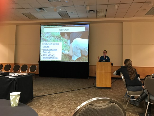 CSP Program Lead Kelly Coy speaking in front of a screen and a room full of people at the Citizen Science Association conference