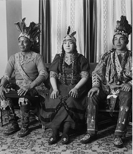 Three native americans seated