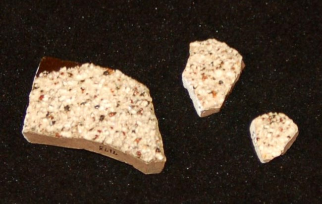 Three fragments of ceramic with rough surface