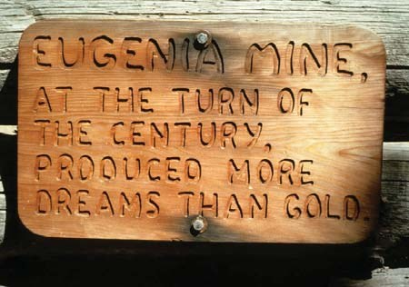 Sign from miners cabin near the mine. Says: At the turn of the century produced more dreams than gold.