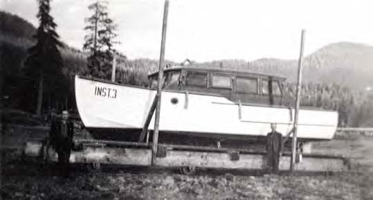 "Black and white photo of a boat with writing ""INST. 3"" on bow"