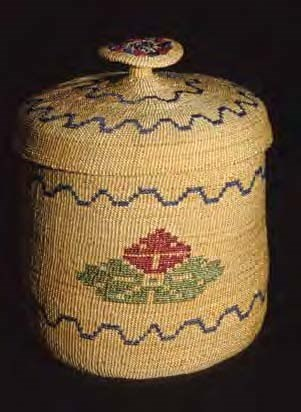 Woven basket with flower design and lid with a woven knob