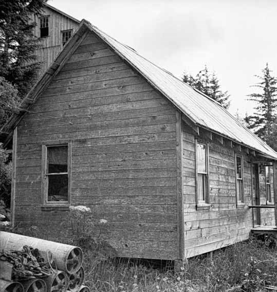Black and white photo of a wood framed building.