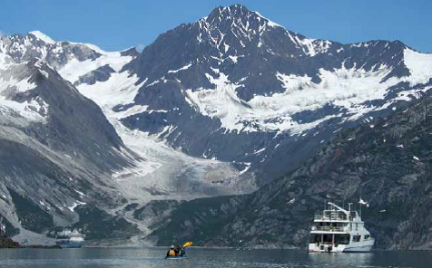 A cruise ship, kayak, and tour boat in Glacier Bay