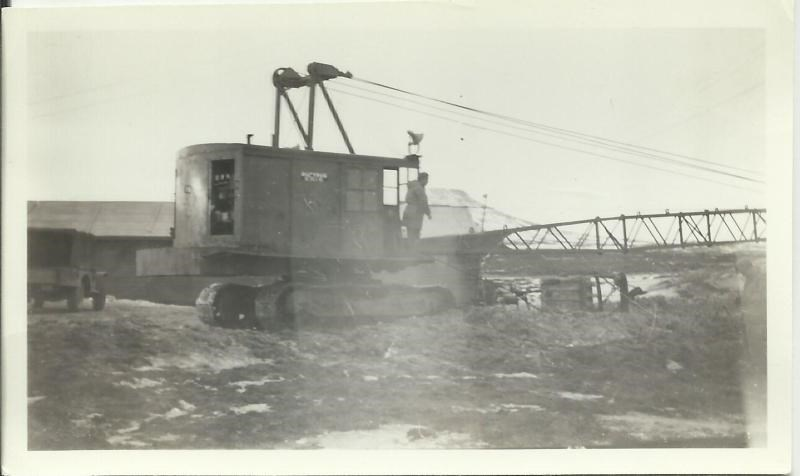 Black and white photo of a crane in the mud