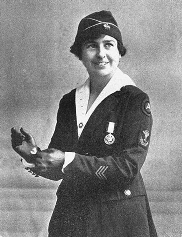 Woman in military service uniform.