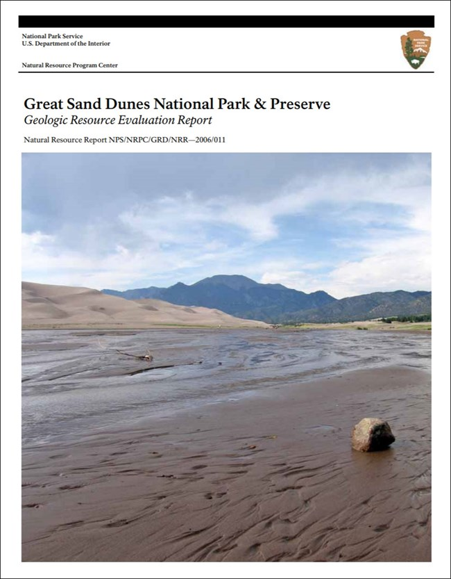gri report cover with photo of stream, dunes, and mountains