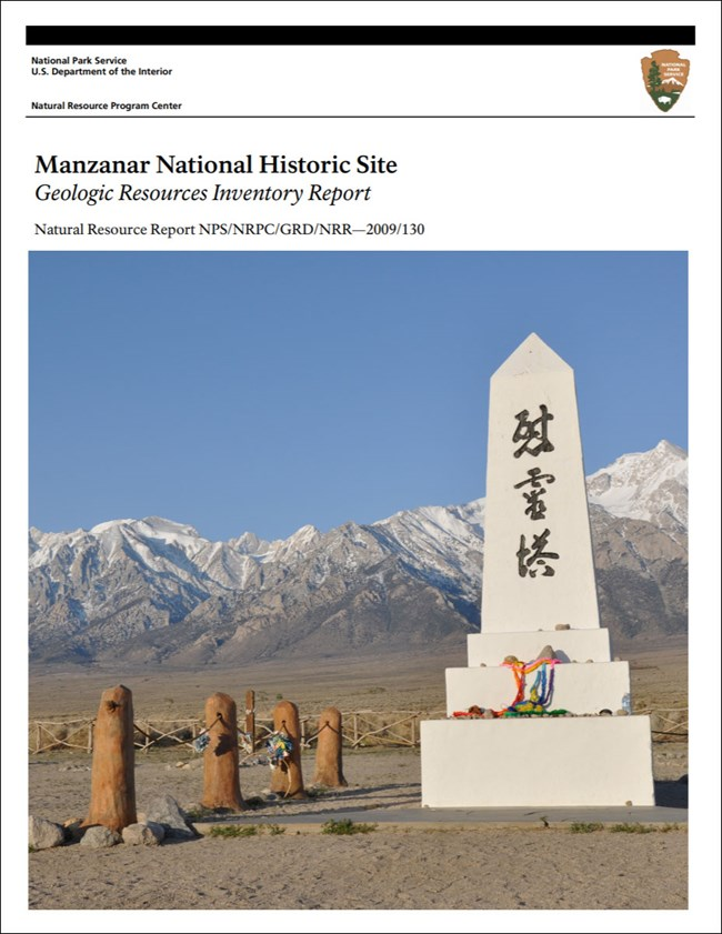 image of manznar gri report cover with image of monument and mountains