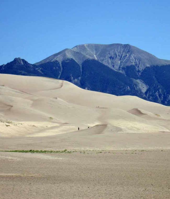 sand dunes with mountains beyond