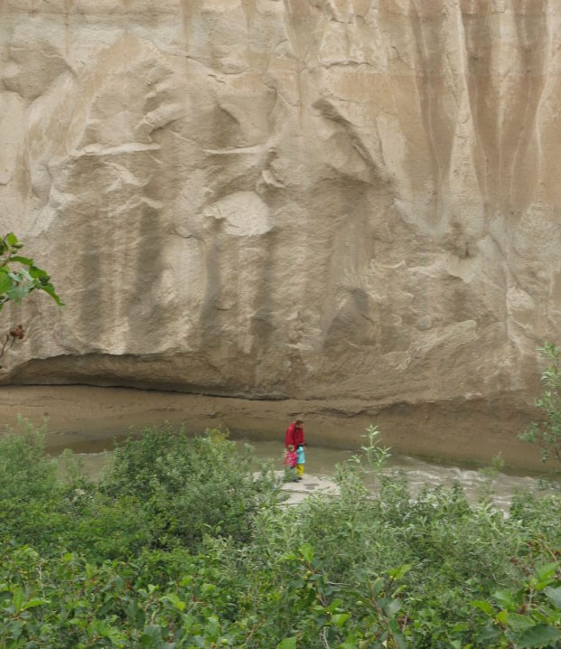 pyroclastic deposit forms cliff along stream bank