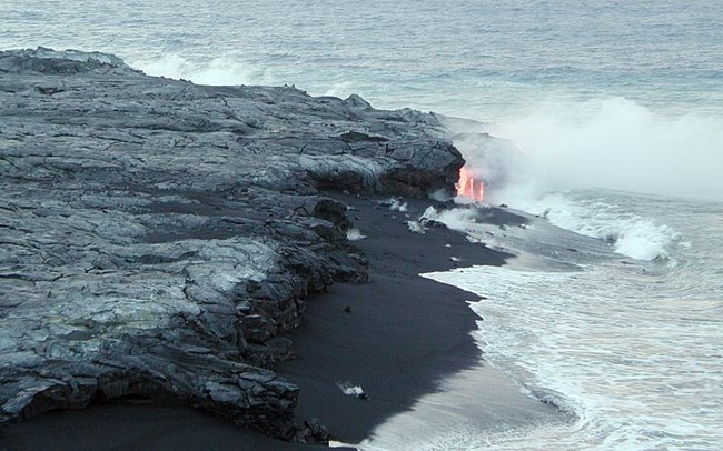 lava and black sand on beach
