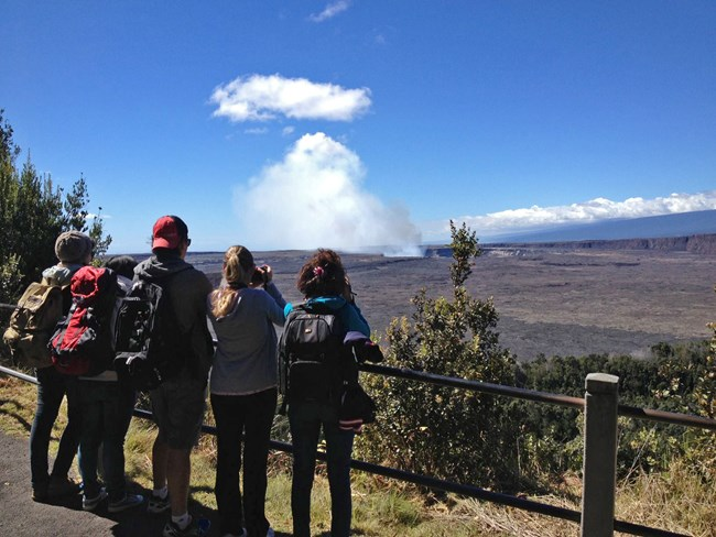 Visotors watch a steam plume from the Jagger Visitor center at Hawaii Volcanoes NP