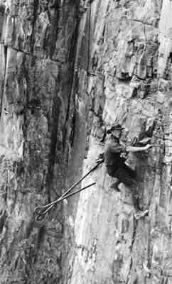 Worker on a sheer cliff face.