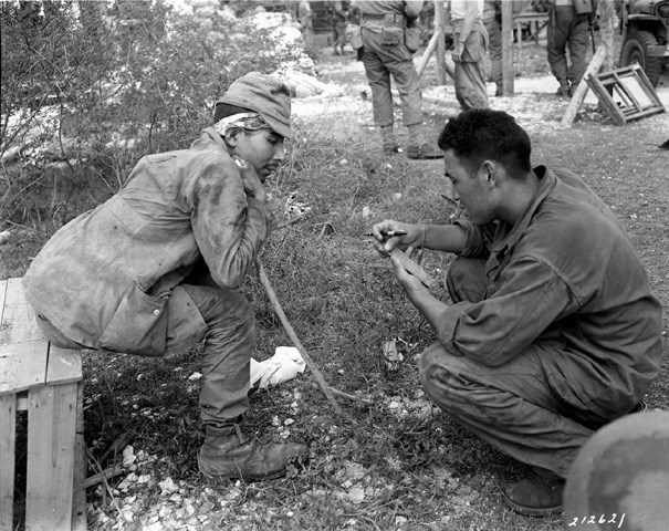 Military Intelligence Language School graduate interrogates a captured Japanese soldier.
