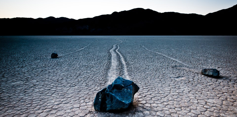 Boulders leave a mysterious trail in a dry lakebed