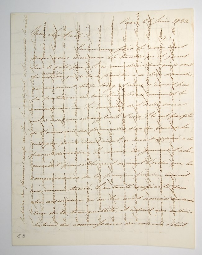 Handwritten letter with criss-crossing lines of text