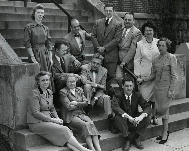 A group of people posed on steps for a photo. From Collections of the Smithsonian Institution Archives