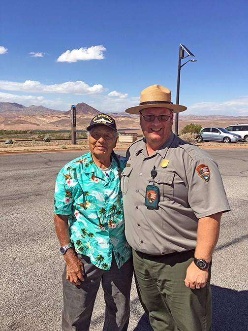 ranger stand beside a veteran outside at Lake Mead
