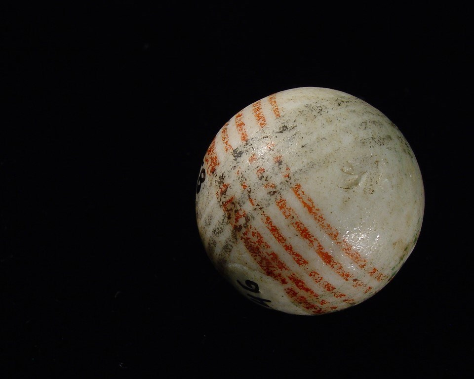 White marble with black and red stripes.
