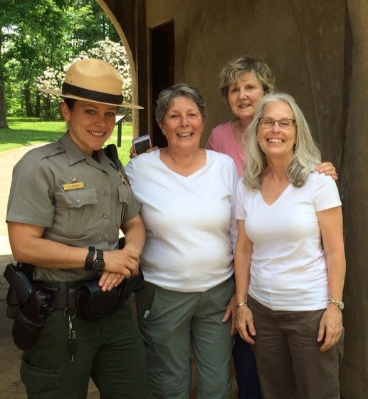 A NPS ranger standing with the volunteers of the Monarch Mafia