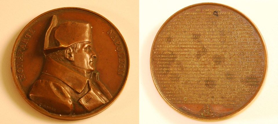 Image showing front and back of medal. On front is profile portrait of Napoleon. On back is text of a speech given by Napoleon.