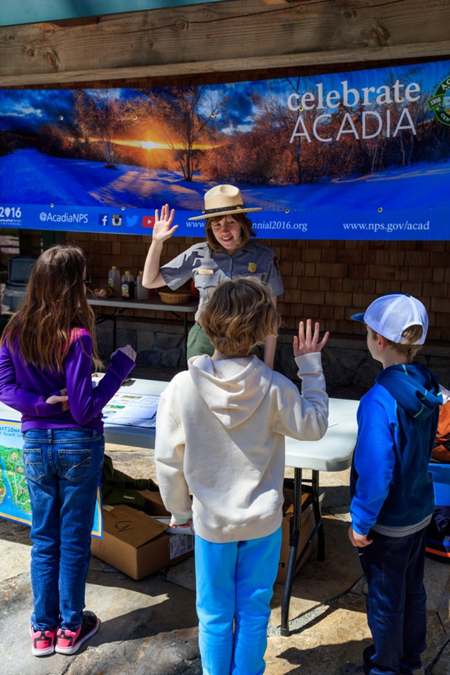 National Park Service Ranger with children at Acadia National Park. NPS photo.