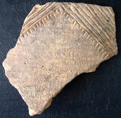 [photo] Pottery sherd decorated with linear patterns.