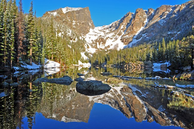 Hallett Peak reflected in the water of Dream Lake in Rocky Mountain NP