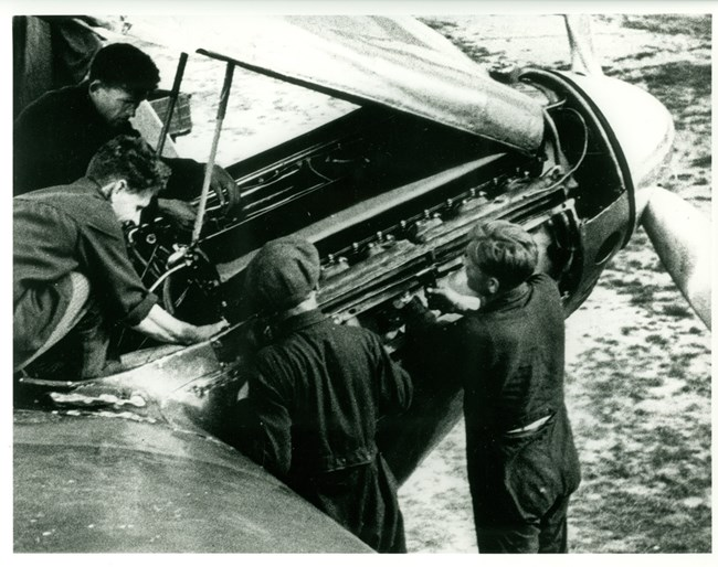 Photo of mechanics working on engine