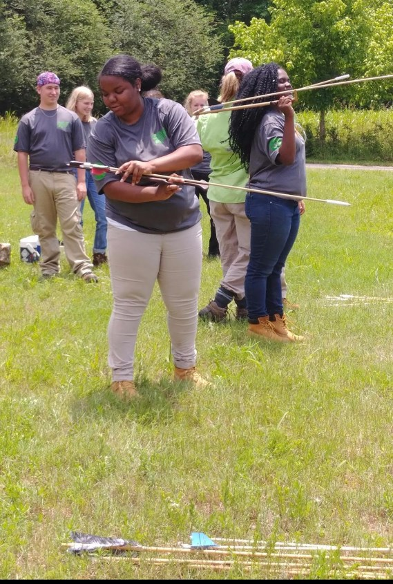UAC participants learning how to use an atlatl