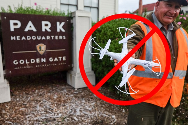 A man in an orange vest holds a quadcopter. A circle with a slash overlays the quadcopter.