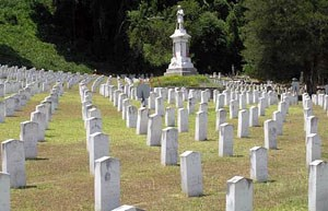 Rows of uniform marble headstones.