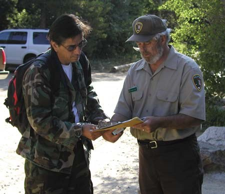 Volunteers distributed a survey, camera, and journal to hikers at trailheads.
