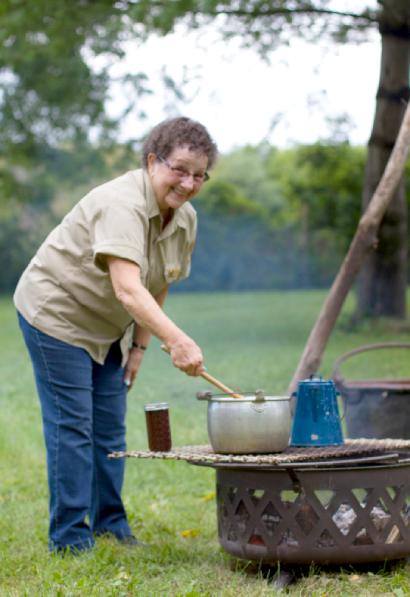 Volunteer stirring apple butter at Apples Fest