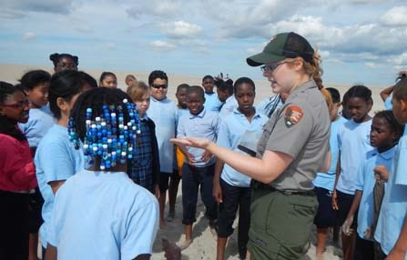 Ranger with students on beach