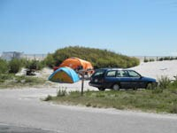 Oceanside Campground with tents and car on site, 34kb.