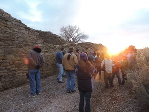 Visitors observing winter solstice sunset with a ranger.