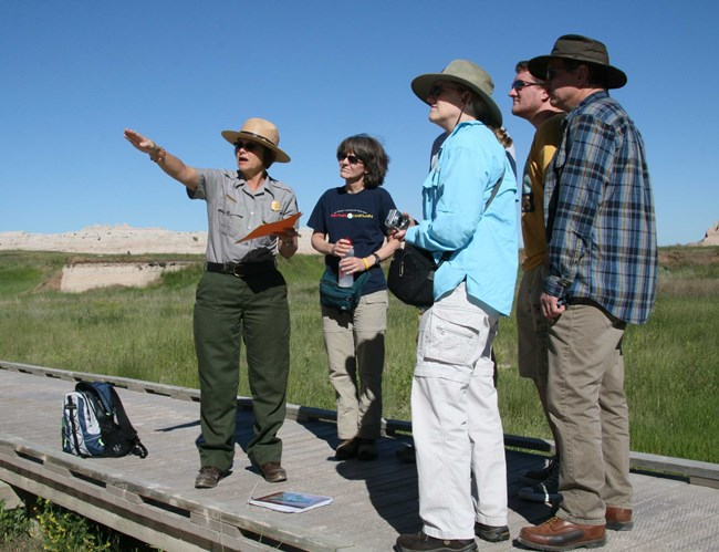 Teacher Ranger Dottie Hartman leads a ranger walk.
