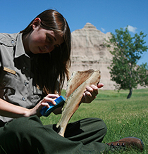 high school intern scrubs bison bone with badlands formations in the background