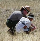 Ranger sharing the wonders of the prairie with a child