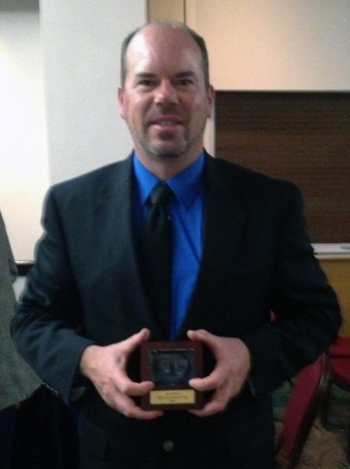 Ranger Aaron Kaye with his award