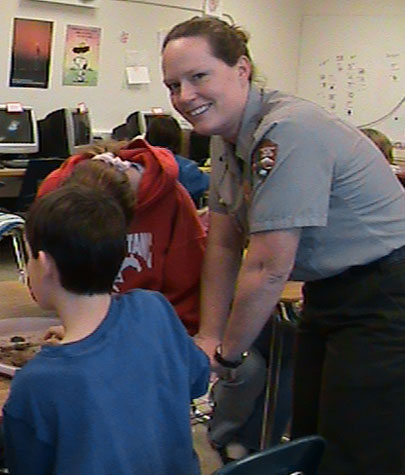 Ranger Shoup presents an educational program in a local school's classroom.