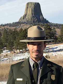 Deputy Superintendent Reed Robinson stands in front of Devil's Tower NM.