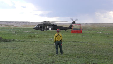 Park staff standing in front of helicopter