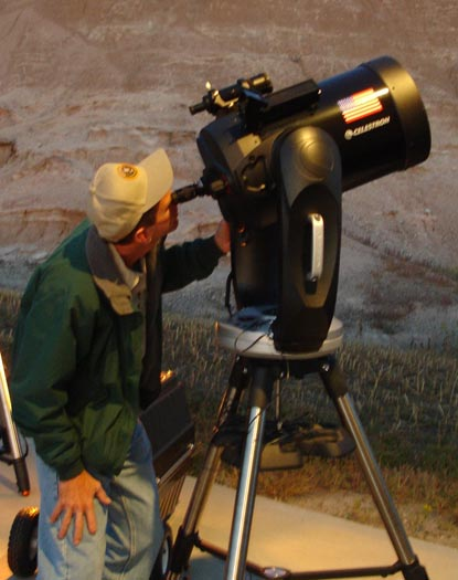 National Park Service volunteer views the park's night sky through an 11