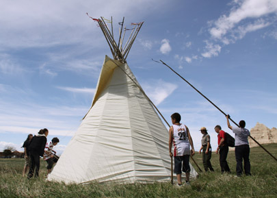 Rockyford School students set up the park's tipi.