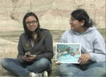 Two students sitting in the badlands